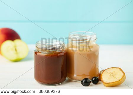 Glass Jars With Nutrient Baby Food On Blue Background. Vegetable And Fruit Puree