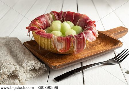 Melon With Air Dried Ham, Served In Halved Melon Stuffed With Serrano Ham And Melon Balls. Copy Spac