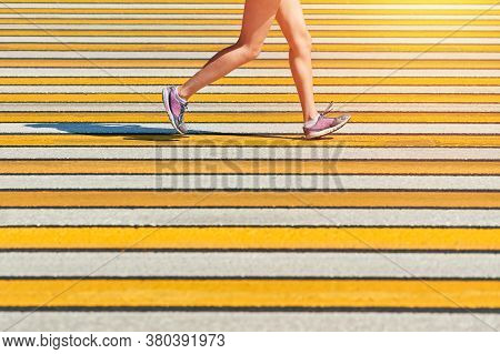 Woman Running Crosswalk, Copy Space. Athletic Woman Jogging In Sportswear On City Road. Healthy Life