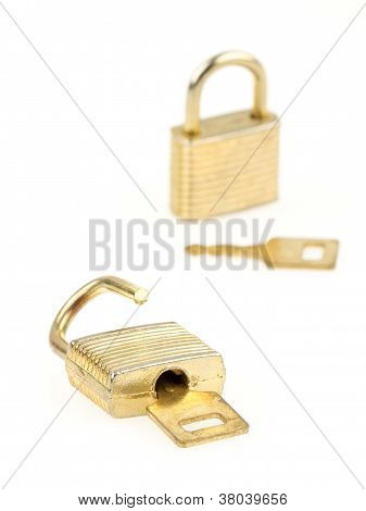 Opened En Closed Padlocks And Keys Isolated, Focus In The Front