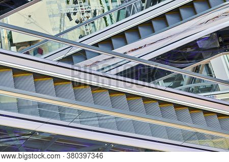 Crisscross Escalators In Shopping Center. Empty Escalators Stairs Up And Down In Office Building, Sh