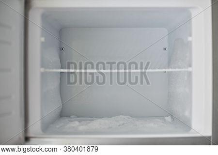 Ice Buildup In Freezer. Broken Frozen Refrigerator With Built Up Ice And Frost. Empty Freezer Drain