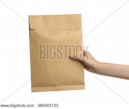 Woman Holding Kraft Paper Envelope On White Background, Closeup