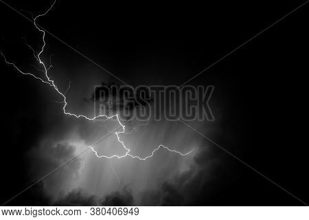 Black And White Photo Of A Lightning During A Storm On A Hot Summer Night