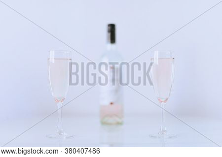 Two Glasses Of Pink Champagne With Bottle. Romantic Date Or Celebration Anniversary. Couple Alcohol