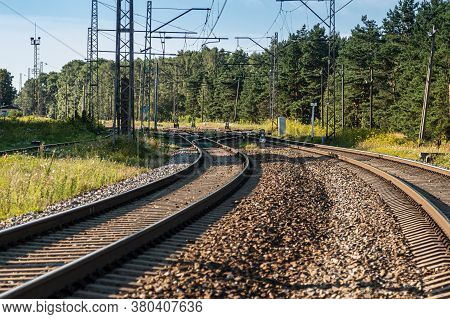 Railroad Tracks On A Sunny Day. Railway Concept. Rail Transport