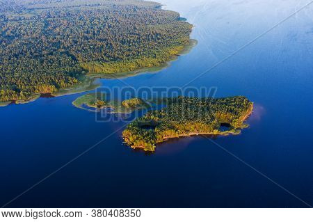 Aerial view of the island with forest on the wide river of Kama, Russia