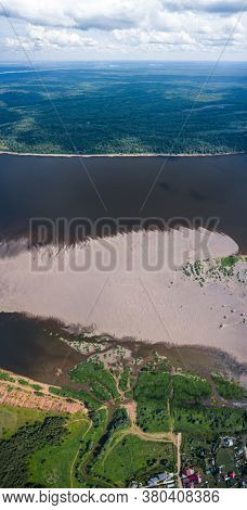Aerial panorama of the river of Kama with wide sandy coast. Russia