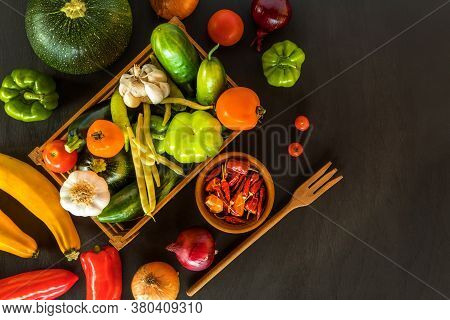 Fresh Vegetables A Top View Of Ripe Vegetables. Different Types Of Fresh Vegetables On A Black Woode