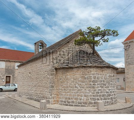 Small Ancient Christian Church In The Village Of Nerezisce On The Island Of Brac In Croatia. Little
