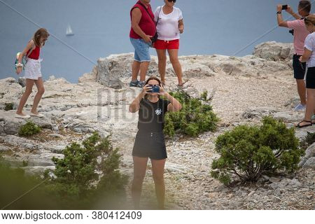 Vidova Gora, Croatia, August 2020 A Group Of Tourists Posing And Taking Photos On The Highest Point