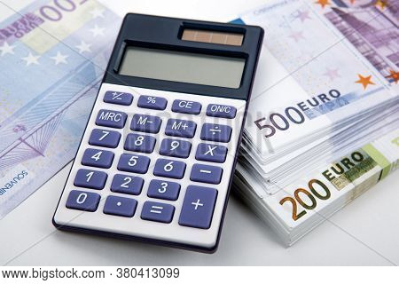 Business Still-life From A Calculator And A Bundle Of Banknotes 500 And 200 Euros Close Up