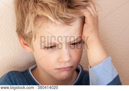 portrait of a small Caucasian child sulking