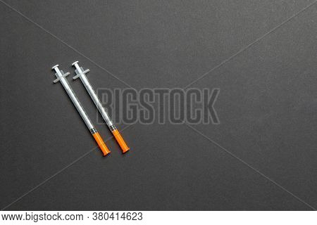 Top View Of Two Insulin Syringe At Colorful Background With Copy Space. High Level Of Glucose Concep
