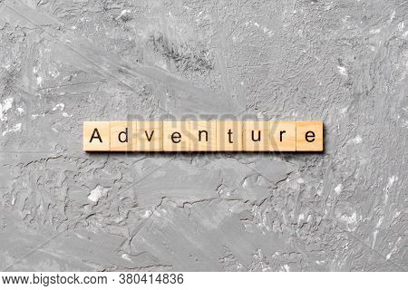Adventure Word Written On Wood Block. Adventure Text On Cement Table For Your Desing, Concept