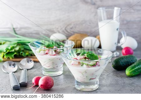 The National Russian Dish Is Okroshka. Cold Soup With Vegetables, Sausages And Herbs On Kefir In Gla