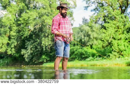 Some Kind Meditation. Fish Normally Caught In Wild. Trout Farm. Fisherman Alone Stand In River Water