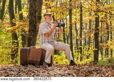 Used To Manual Settings. Old Man Shoot In Nature. Landscape And Nature Photo Shooting. Old Photograp