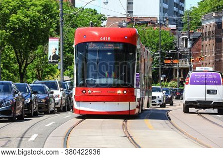 TORONTO, CANADA - 22,JUNE 2019: A view of the new Toronto Street Cars during the day. Toronto streetcar system is a network of ten streetcar routes in Toronto, Ontario, Canada