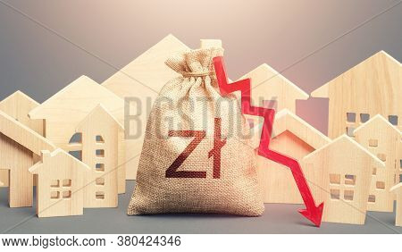 City Residential Buildings And Polish Zloty Money Bag With A Red Down Arrow. Lower Mortgage Interest