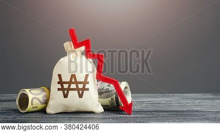 South Korean Won Money Bag And Red Down Arrow. Economic Difficulties Fall. Capital Flow, High Risks.