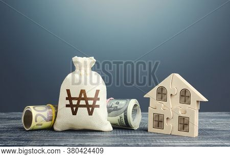 South Korean Won Money Bag And Puzzle House. Mortgage Loan On Purchase, Building Maintenance And Uti