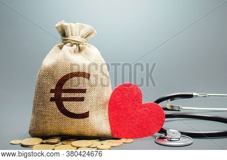 Euro Money Bag And Stethoscope. Health Life Insurance And Financing Concept. Subsidies, Investments.