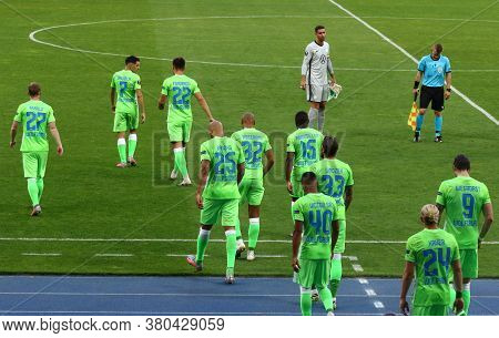 Kyiv, Ukraine - August 5, 2020: Vfl Wolfsburg Players Go To The Pitch During The Uefa Europa League