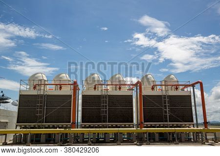 Cooling Towers In Data Center Building. Air Conditioning Cooling Towers In Front Of Building With Fi