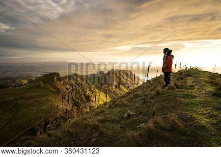 Man And Woman Contemplating The Beautiful Landscape At Te Mata Peak, Hawke's Bay, New Zealand. Horiz