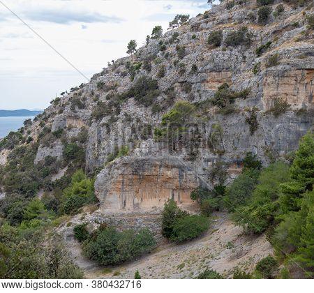 Cliffs Surrounding The Pustinja Blaca, Deserted Remote Area On The Island Of Brac In Croatia