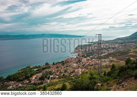 View Of The Coastal Town Of Bol On The Island Of Brac From A Nearby Observation Point On The Road