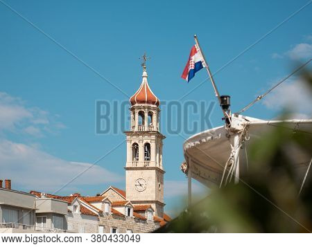 View Of The Christian Church Belltower In The Small Town Of Sutivan On The Island Of Brac. Croatian