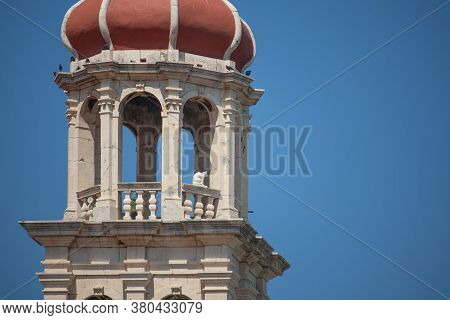 Zoomed In View Of The Christian Church Belltower In The Small Town Of Sutivan On The Island Of Brac.