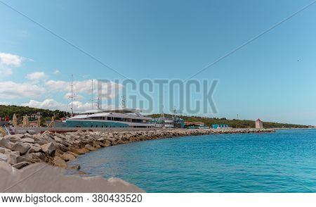 View Of Large Yachts Docked In The Port Of Postira, Small Town On The Island Of Brac In Croatia. War
