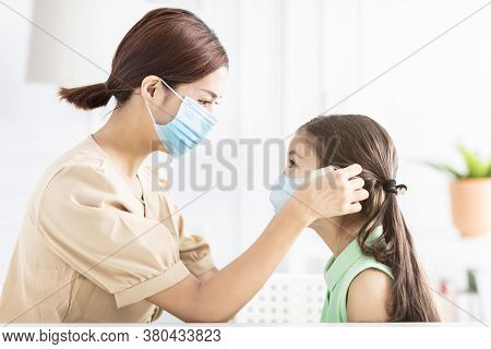 Mother Help Her Daughter Wearing Healthy Face Mask