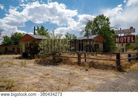 Shoshoni, Wyoming - July 25, 2020: Abandoned Shoshoni Motel, With Its Vintage Neon Sign Sits Decayin