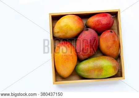 Tropical Fruit, Mango In Wooden Box On White Background. Top View