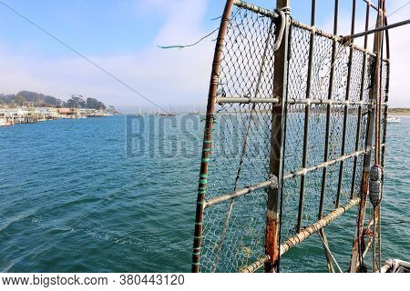Fishing Net On The Side Of A Fishing Vessel Docked In Morro  Bay, Ca Where People Can Dock Their Fis