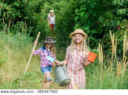 On Way To Family Farm. Taking Care Of Plants. Sisters Helping At Farm. Girls With Gardening Tools. E