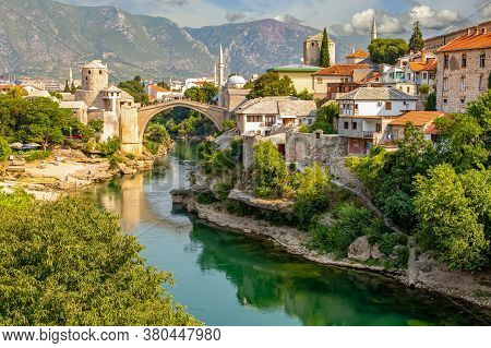 Mostar Bridge In Bosnia And Herzegovina. Colorful Landscape In The City Of Mostar With A Bridge And