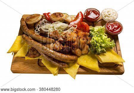 Grill Set On A Wooden Board Grilled Chicken Skewers, Pork Skewers, Grilled Sausages, Vegetables, Mar