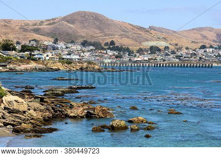 August 3, 2020 In Cayucos, Ca:  Rocks And Tide Pools On The California Central Coast With The Beach
