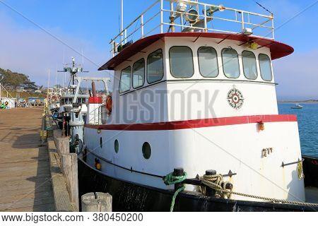 August 3, 2020 In Morro Bay, Ca:  Rustic Vintage Fishing Vessel Docked In The Morro Bay, Ca Harbor W
