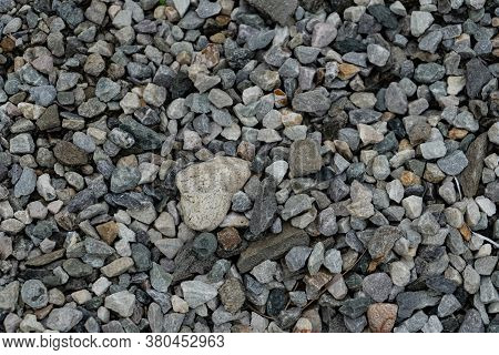 Abstract Design Formed By Various Numbers Of Pebbles Scattered In The Lawn, Background Texture Of Pe