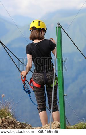 Girl Climber On A Bridge In The Mountains.