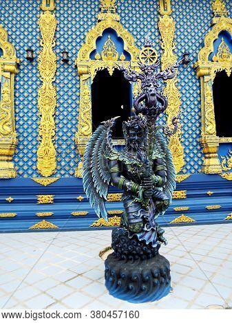 Chiang Rai. Thailand, June 16, 2017: Wat Rong Suea Ten. Blue Sculpture On The Exterior Of The Blue T