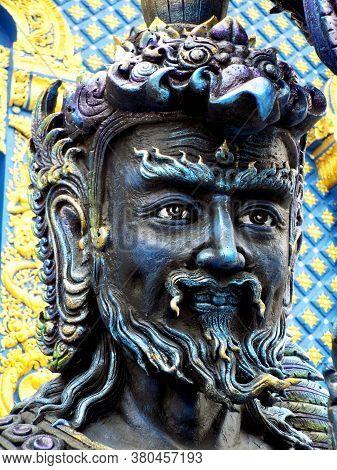 Chiang Rai. Thailand, June 16, 2017: Wat Rong Suea Ten. Close-up Of A Blue Sculpture Outside The Blu