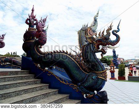 Chiang Rai. Thailand, June 16, 2017: Wat Rong Suea Ten. A Dragon From The Blue Temple In Chiang Rai.