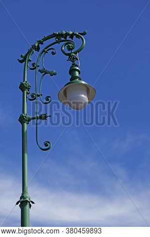 A Very Beautiful Green Lamppost With Lots Of Ornaments